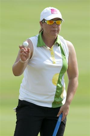 CHON BURI, THAILAND - FEBRUARY 19:  Karen Stupples of England acknowledges to the crowd on the 18th green during day three of the LPGA Thailand at Siam Country Club on February 19, 2011 in Chon Buri, Thailand.  (Photo by Victor Fraile/Getty Images)