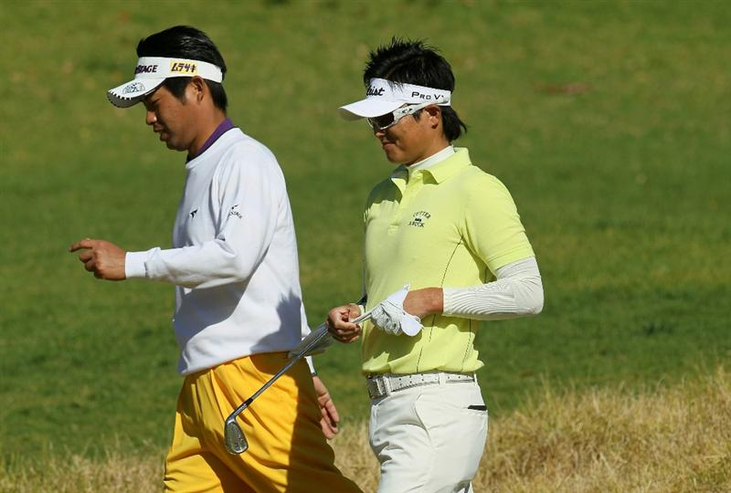 PACIFIC PALISADES, CA - FEBRUARY 17:  Yuta Ikeda (L) and Ryuji Imada of Japan walk together on the fifth hole during round one of the Northern Trust Open at Riviera Counrty Club on February 17, 2011 in Pacific Palisades, California.  (Photo by Stephen Dunn/Getty Images)
