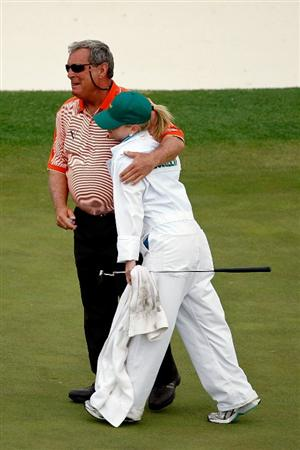 AUGUSTA, GA - APRIL 10:  Fuzzy Zoeller hugs his daughter/caddie Gretchen after his final Masters at the 2009 Masters Tournament at Augusta National Golf Club on April 10, 2009 in Augusta, Georgia.  (Photo by Jamie Squire/Getty Images)