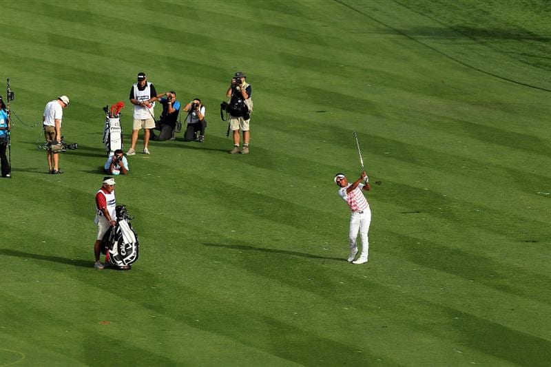 DUBAI, UNITED ARAB EMIRATES - FEBRUARY 07:  Thongchai Jaidee of Thailand plays his second shot at the 18th hole during the final round of the 2010 Omega Dubai Desert Classic on the Majilis Course at the Emirates Golf Club on February 7, 2010 in Dubai, United Arab Emirates.  (Photo by David Cannon/Getty Images)