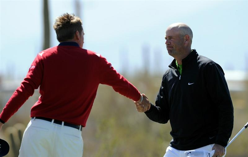 MARANA, AZ - FEBRUARY 23:  Ian Poulter of England congralutates Stewart Cink on the first extra hole of their match during the first round of the World Golf Championships-Accenture Match Play Championship held at The Ritz-Carlton Golf Club, Dove Mountain on February 23, 2011 in Marana, Arizona.  (Photo by Stuart Franklin/Getty Images)