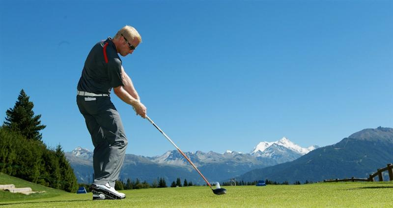 CRANS, SWITZERLAND - SEPTEMBER 01:  Simon Dyson of England tees off on the seventh hole during the Pro Am prior to the start of The Omega European Masters at Crans-Sur-Sierre Golf Club on September 1, 2010 in Crans Montana, Switzerland.  (Photo by Warren Little/Getty Images)