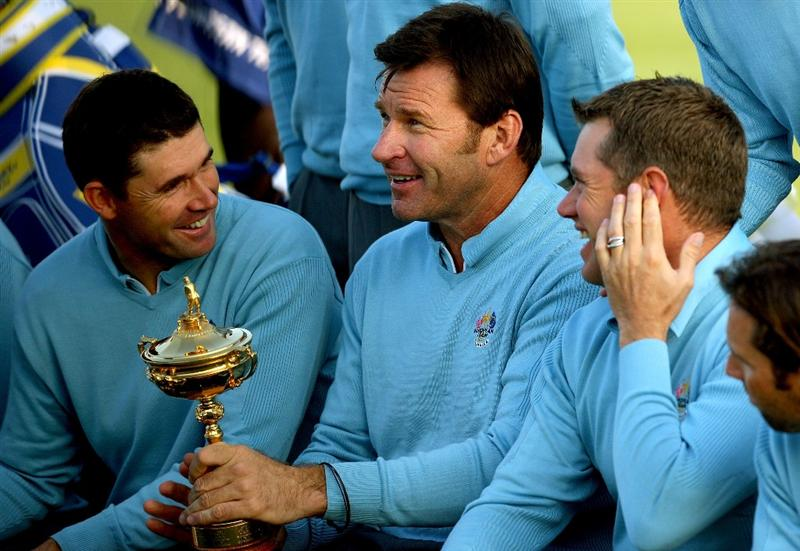 LOUISVILLE, KY - SEPTEMBER 16:  European team captain Nick Faldo holds the trophy as he jokes with Padraig Harrington (L) and Lee Westwood (R) during the European Team photo shoot prior to the start of the 2008 Ryder Cup at Valhalla Golf Club of September 16, 2008 in Louisville, Kentucky.  (Photo by Andrew Redington/Getty Images)