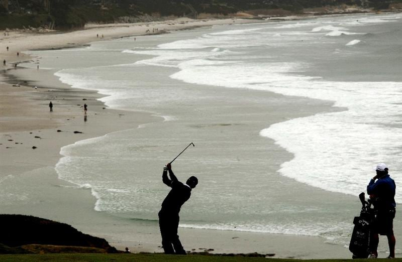 PEBBLE BEACH, CA - JUNE 14:  Graeme McDowell of Northern Ireland watches a shot as his caddie Ken Comboy looks on during a practice round prior to the start of the 110th U.S. Open at Pebble Beach Golf Links on June 14, 2010 in Pebble Beach, California.  (Photo by Andrew Redington/Getty Images)