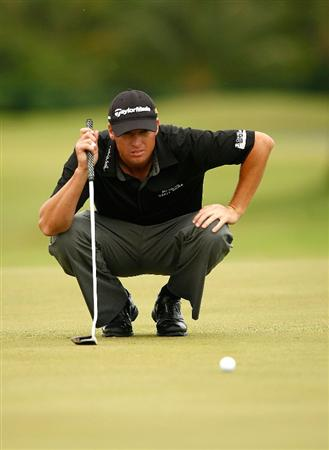 RIO GRANDE, PR - MARCH 13:  John Mallinger lines up a putt on the 13th hole during the second round of the 2009 Puerto Rico Open presented by Banco Popular on March 13, 2009 at the Trump International Golf Club in Rio Grande, Puerto Rico.  (Photo by Mike Ehrmann/Getty Images)