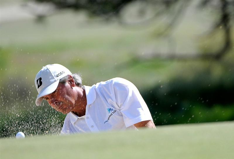 PARKER, CO - MAY 28: Fred Couples hits out of the greenside bunker on the 8th hole during the second round of the Senior PGA Championship at the Colorado Golf Club on May 28, 2010 in Parker, Colorado.  (Photo by Marc Feldman/Getty Images)