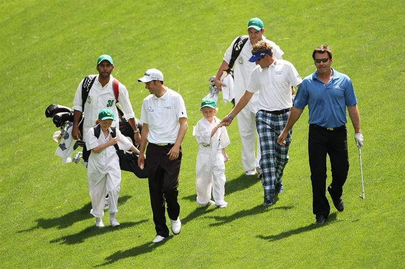 AUGUSTA, GA - APRIL 07:  (L-R) Ross Fisher, Ian Poulter and Nick Faldo of England walk with their caddies during the Par 3 Contest prior to the 2010 Masters Tournament at Augusta National Golf Club on April 7, 2010 in Augusta, Georgia.  (Photo by Jamie Squire/Getty Images)