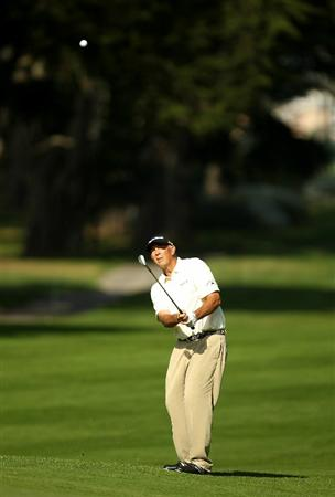 SAN FRANCISCO - NOVEMBER 06:  Tom Lehman hits his approach shot on the 5th hole during round 3 of the Charles Schwab Cup Championship at Harding Park Golf Course on November 6, 2010 in San Francisco, California.  (Photo by Ezra Shaw/Getty Images)