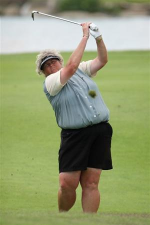 SINGAPORE - MARCH 04:  Laura Davies of England plays her second shot on the par four 17th hole during the pro am event prior to the HSBC Women's Champions at the Tanah Merah Country Club on March 4, 2009 in Singapore.  (Photo by Ross Kinnaird/Getty Images)