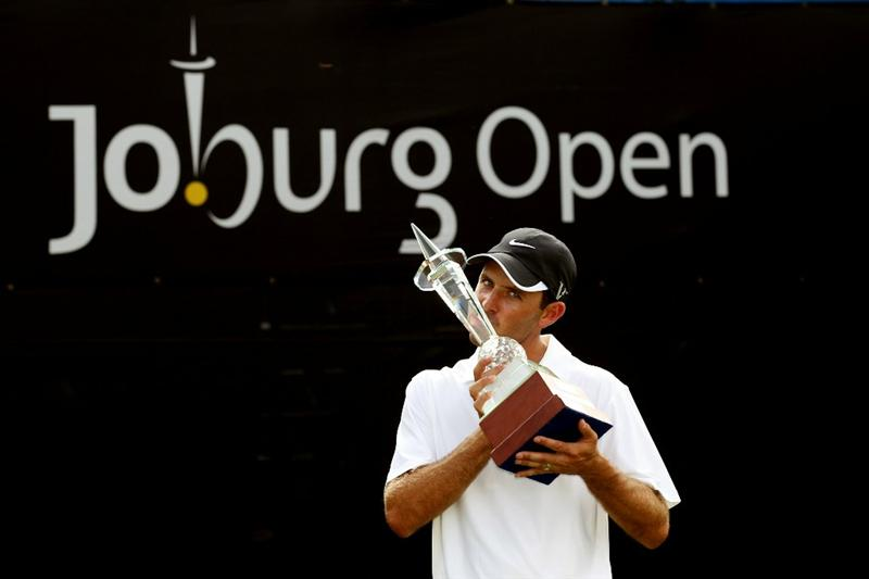 JOHANNESBURG, SOUTH AFRICA - JANUARY 16:  Charl Schwartzel of South Africa poses with the trophy after winning the Joburg Open at Royal Johannesburg and Kensington Golf Club on a score of -19 under par on January 16, 2011 in Johannesburg, South Africa.  (Photo by Warren Little/Getty Images)