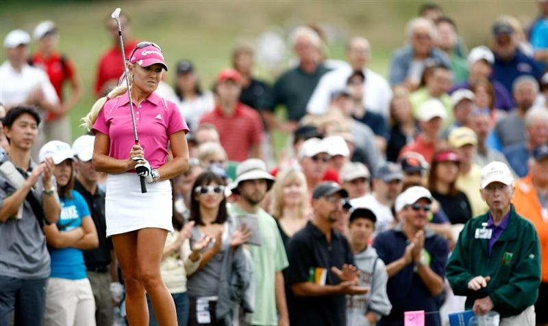 NORTH PLAINS, OR - AUGUST 29:  Natalie Gulbis watches her third shot on the 9th  hole during the second round of the Safeway Classic on August 29, 2009 on the Ghost Creek course at Pumpkin Ridge in North Plains, Oregon.  (Photo by Jonathan Ferrey/Getty Images)