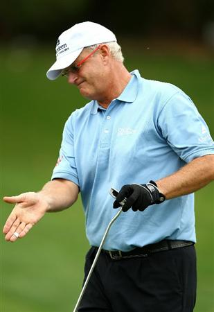 PERTH, AUSTRALIA - NOVEMBER 21:  Sandy Lyle of Scotland reacts to a missed putt on the 4th hole during day three of the 2010 Australian Senior Open at Royal Perth Golf Club on November 21, 2010 in Perth, Australia.  (Photo by Paul Kane/Getty Images)