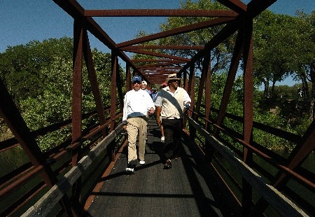 Joe Inman and Jim Thorpe head for the 16th tee during the second round of the FedEx Kinko's Classic at The Hills Country Club in Austin, Texas April 30, 2005.Photo by Steve Grayson/WireImage.com