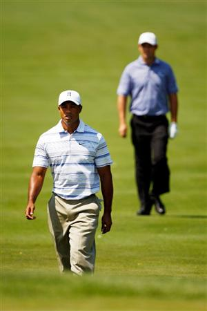 CHASKA, MN - AUGUST 14:  Tiger Woods and Padraig Harrington walk to the first green during the second round of the 91st PGA Championship at Hazeltine National Golf Club on August 14, 2009 in Chaska, Minnesota.  (Photo by Streeter Lecka/Getty Images)