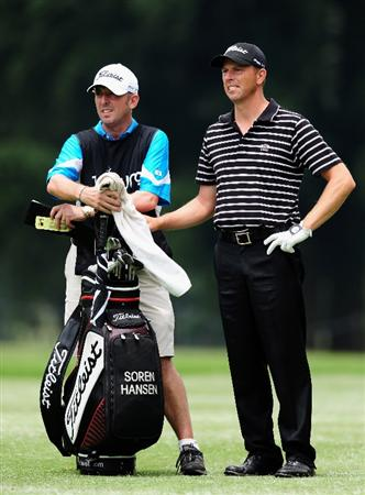 JOHANNESBURG, SOUTH AFRICA - JANUARY 14:  Soren Hansen of Denmark and caddie  Phil Morbey  during the first round of the Joburg Open at Royal Johannesburg and Kensington Golf Club on January 14, 2010 in Johannesburg, South Africa.  (Photo by Stuart Franklin/Getty Images)