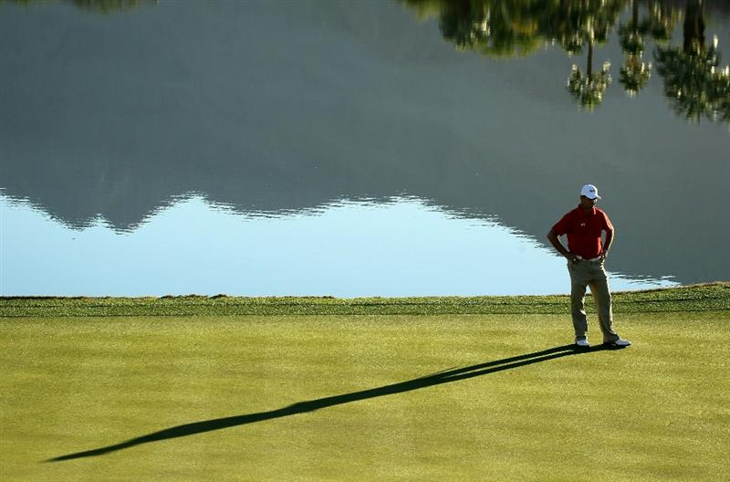 LA QUINTA, CA - JANUARY 21:  Gary Woodland waits to putt on the 18th hole during round three of the Bob Hope Classic at the Nicklaus Private Course at PGA West on January 21, 2011 in La Quinta, California.  (Photo by Stephen Dunn/Getty Images)