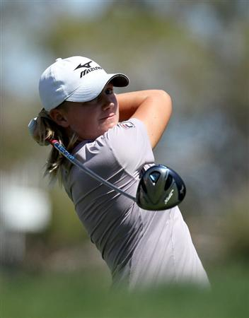 RANCHO MIRAGE, CA - APRIL 03:  Stacy Lewis hits her tee shot on the third hole during the final round of the Kraft Nabisco Championship at Mission Hills Country Club on April 3, 2011 in Rancho Mirage, California.  (Photo by Stephen Dunn/Getty Images)