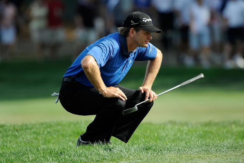 PALM HARBOR, FL - MARCH 22:  Retief Goosen of South Africa looks over a birdie putt on the 12th hole during the final round of the Transitions Championship at the Innisbrook Resort and Golf Club on March 22, 2009 in Palm Harbor, Florida.  (Photo by Sam Greenwood/Getty Images)