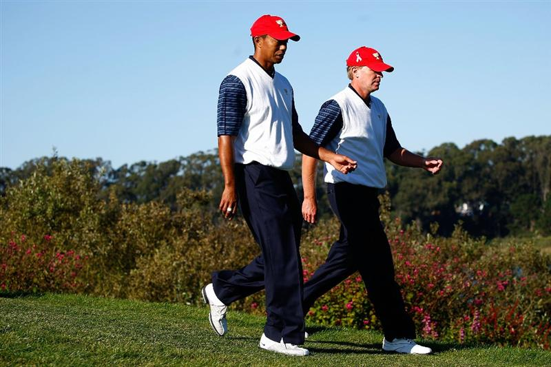 SAN FRANCISCO - OCTOBER 09:  Tiger Woods and Steve Stricker of the USA Team walk off on the 15th tee during the Day Two Fourball Matches of The Presidents Cup at Harding Park Golf Course on October 9, 2009 in San Francisco, California.  (Photo by Scott Halleran/Getty Images)