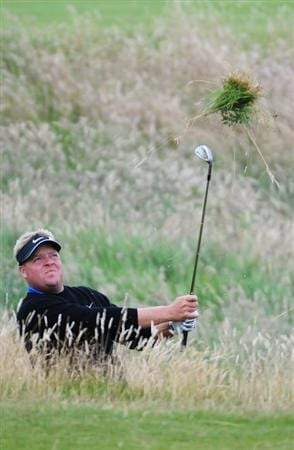 TURNBERRY, SCOTLAND - JULY 17:  Carl Pettersson of Sweden hits out of the rough during round two of the 138th Open Championship on the Ailsa Course, Turnberry Golf Club on July 17, 2009 in Turnberry, Scotland.  (Photo by Harry How/Getty Images)