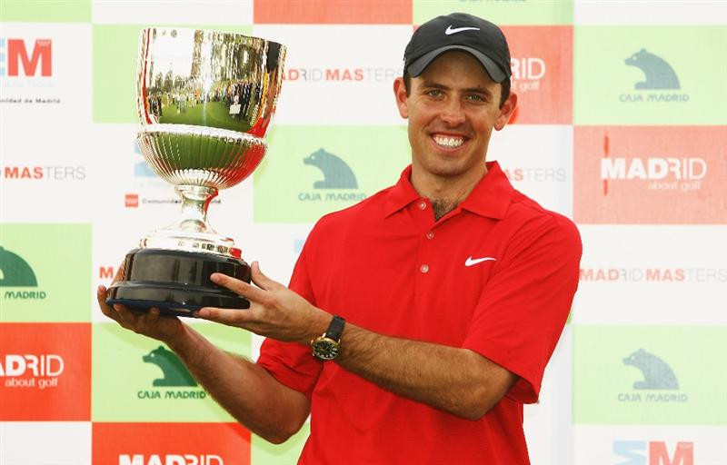 MADRID, SPAIN - OCTOBER 12:  Charl Schwartzel of South Africa celebrates with Madrid Masters trophy after winning the  Final round of the Madrid Masters at the Club de Campo Villa de Madrid on October 12, 2008 in Madrid, Spain.  (Photo by Ian Walton/Getty Images)