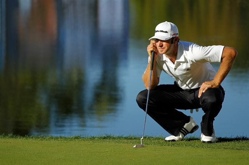 LEMONT, IL - SEPTEMBER 12:  Dustin Johnson waits on the 18th green during the final round of the BMW Championship at Cog Hill Golf & Country Club on September 12, 2010 in Lemont, Illinois.  (Photo by Scott Halleran/Getty Images)