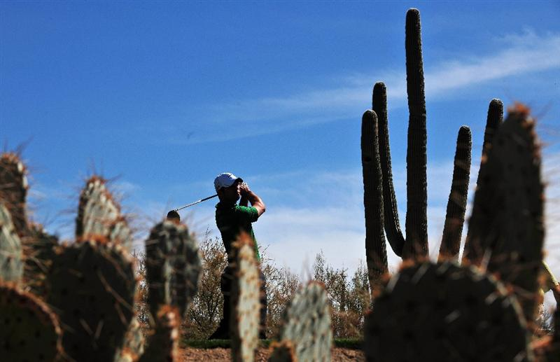 MARANA, AZ - FEBRUARY 27:  Paul Casey of England plays his tee shot on the second hole during the third round of Accenture Match Play Championships at Ritz - Carlton Golf Club at Dove Mountain on February 27, 2009 in Marana, Arizona.  (Photo by Stuart Franklin/Getty Images)
