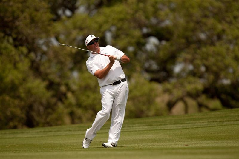 SAN ANTONIO, TX - APRIL 17: Pat Perez follows through on an approach shot during the final round of the Valero Texas Open at the AT&T Oaks Course at TPC San Antonio on April 17, 2011 in San Antonio, Texas. (Photo by Darren Carroll/Getty Images)