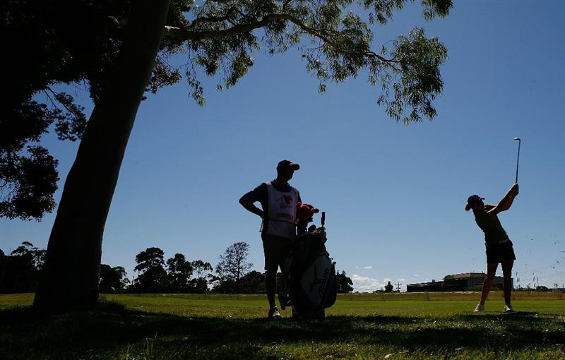 MELBOURNE, AUSTRALIA - MARCH 14:  Stacy Lewis of the USA plays an approach shot on the 4th hole during the final round of the 2010 Women's Australian Open at The Commonwealth Golf Club on March 14, 2010 in Melbourne, Australia.  (Photo by Scott Barbour/Getty Images)