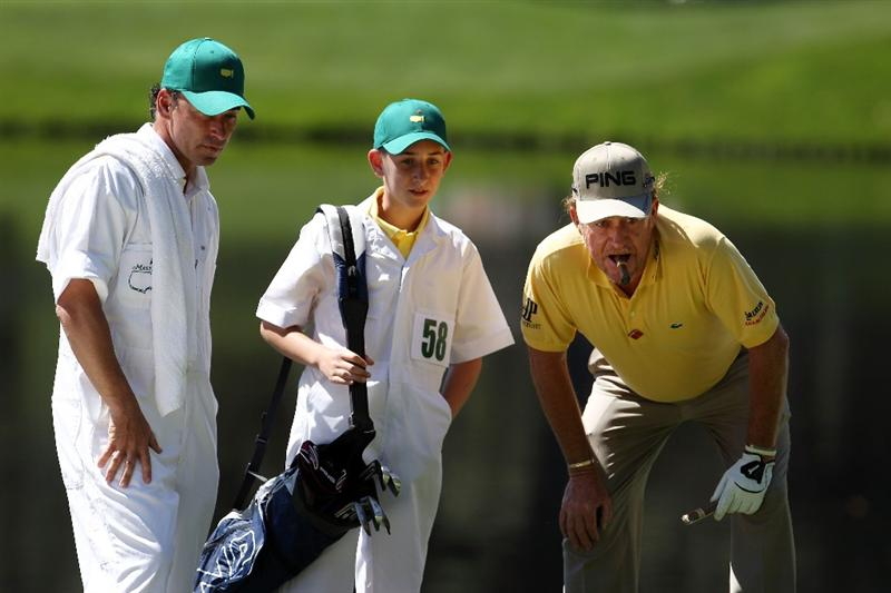AUGUSTA, GA - APRIL 06:  Miguel Angel Jimenez of Spain lines up a putt with his caddie Pepin Liria and son Victor during the Par 3 Contest prior to the 2011 Masters Tournament at Augusta National Golf Club on April 6, 2011 in Augusta, Georgia.  (Photo by Andrew Redington/Getty Images)