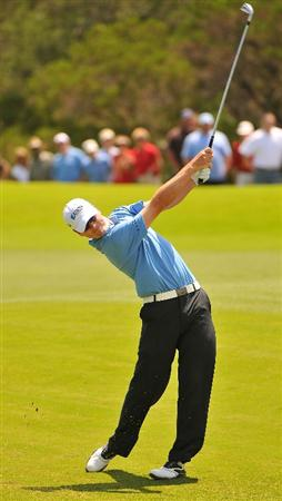 SAN ANTONIO TX - MAY 17: Zach Johnson hits his approach shot into the 1st hole during the fourth and final  round of  the Valero Texas Open held at La Cantera Golf Club on May 17, 2009 in San Antonio, Texas.  (Photo by Marc Feldman/Getty Images)