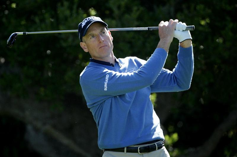 PEBBLE BEACH, CA - JUNE 17:  Jim Furyk watches his tee shot on the 16th hole during the first round of the 110th U.S. Open at Pebble Beach Golf Links on June 17, 2010 in Pebble Beach, California.  (Photo by Andrew Redington/Getty Images)