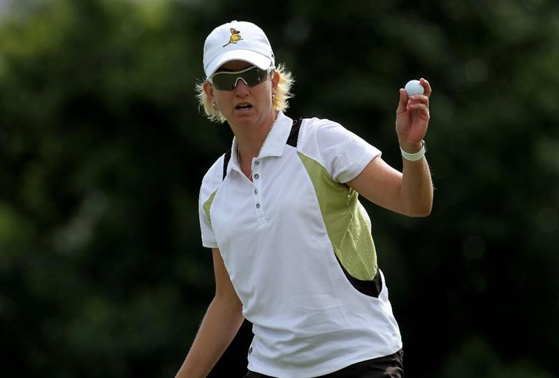 RANCHO MIRAGE, CA - APRIL 02:  Karrie Webb of Australia holds up her ball after making a birdie putt on the 15th hole during the second round of the Kraft Nabisco Championship at Mission Hills Country Club on April 2, 2010 in Rancho Mirage, California.  (Photo by Stephen Dunn/Getty Images)