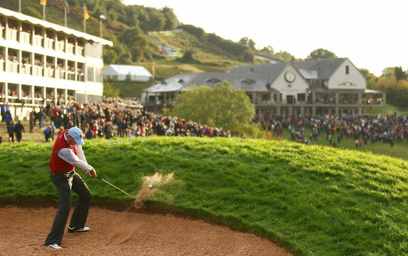 NEWPORT, WALES - OCTOBER 03:  Matt Kuchar of the USA hits a bunker shot on the 18th hole during the  Fourball & Foursome Matches during the 2010 Ryder Cup at the Celtic Manor Resort on October 3, 2010 in Newport, Wales.  (Photo by Richard Heathcote/Getty Images)