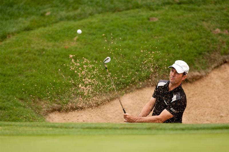 SAN ANTONIO, TX - APRIL 14: Mike Weir of Canada hits a bunker shot during the first round of the Valero Texas Open at the AT&T Oaks Course at TPC San Antonio on April 14, 2011 in San Antonio, Texas. (Photo by Darren Carroll/Getty Images)