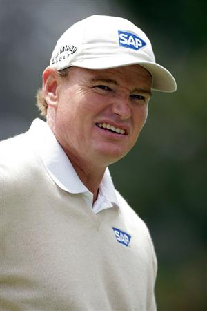 PEBBLE BEACH, CA - JUNE 20:  Ernie Els of South Africa smiles as he walks across a green during the final round of the 110th U.S. Open at Pebble Beach Golf Links on June 20, 2010 in Pebble Beach, California.  (Photo by Andrew Redington/Getty Images)