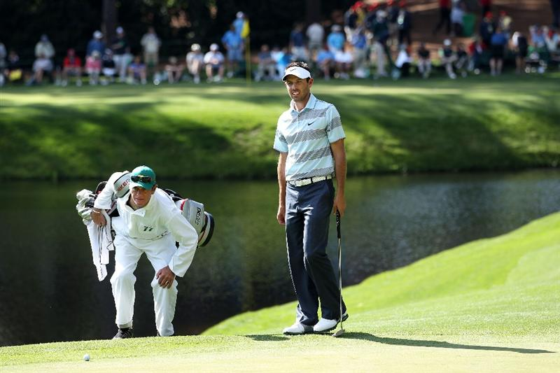 AUGUSTA, GA - APRIL 06:  Charl Schwartzel of South Africa walks with his caddie during the Par 3 Contest prior to the 2011 Masters Tournament at Augusta National Golf Club on April 6, 2011 in Augusta, Georgia.  (Photo by Andrew Redington/Getty Images)