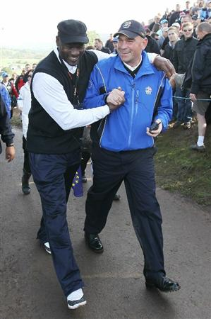 NEWPORT, WALES - OCTOBER 02:  Michael Jordan hugs Europe Vice Captain Thomas Bjorn during the rescheduled Morning Fourball Matches during the 2010 Ryder Cup at the Celtic Manor Resort on October 2, 2010 in Newport, Wales.  (Photo by Andy Lyons/Getty Images)
