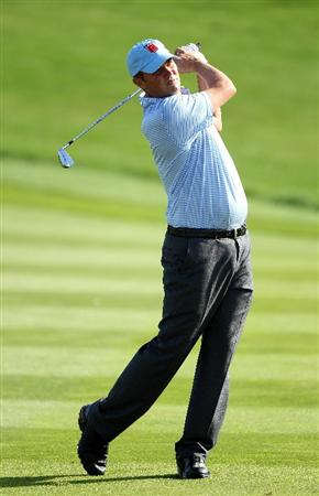NEWPORT, WALES - SEPTEMBER 28:  Jeff Overton of the USA hits an approach shot during a practice round prior to the 2010 Ryder Cup at the Celtic Manor Resort on September 28, 2010 in Newport, Wales.  (Photo by Andy Lyons/Getty Images)
