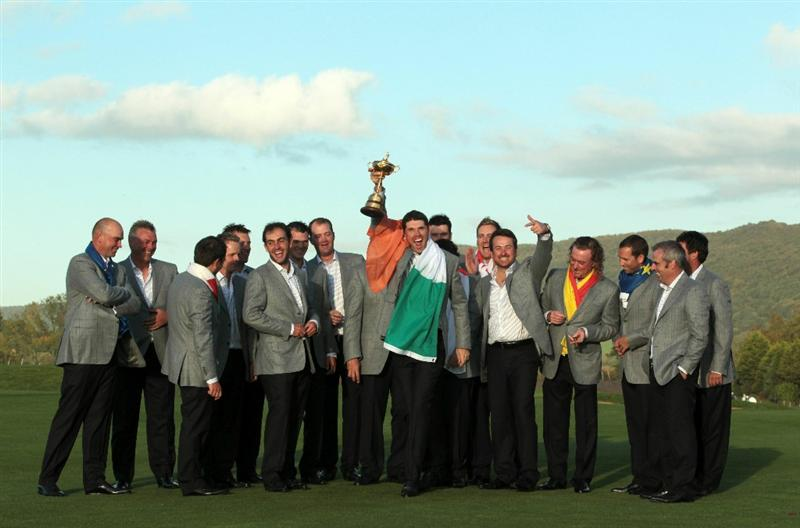 NEWPORT, WALES - OCTOBER 04:  European Team member Padraig Harrington poses with the Ryder Cup alongside his team mates following Europe's 14.5 to 13.5 victory over the USA at the 2010 Ryder Cup at the Celtic Manor Resort on October 4, 2010 in Newport, Wales.  (Photo by David Cannon/Getty Images)