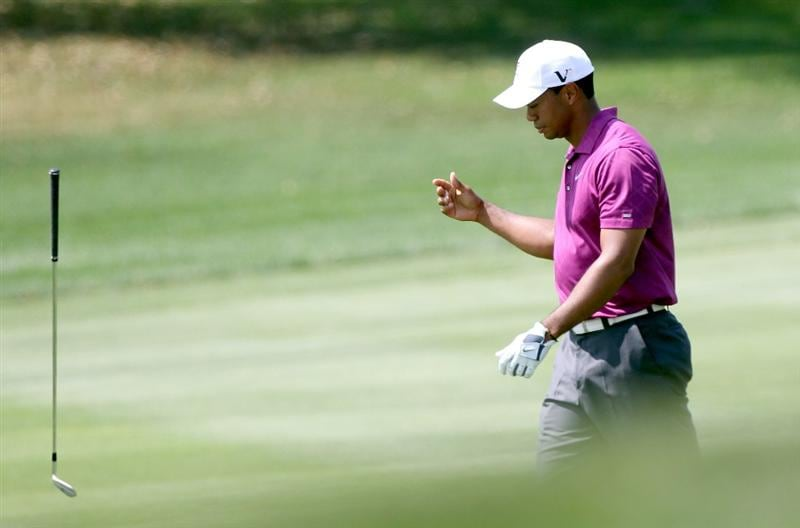 ORLANDO, FL - MARCH 26:  Tiger Woods tosses a club on the 5th hole during the third round of the Arnold Palmer Invitational presented by MasterCard at the Bay Hill Club and Lodge on March 26, 2011 in Orlando, Florida.  (Photo by Sam Greenwood/Getty Images)