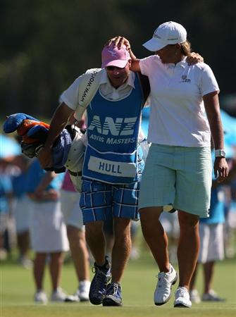 BRISBANE, AUSTRALIA - FEBRUARY 08: Katherine Hull of Australia walks up the 18th hole as she shares a moment with her caddy John Powell during day four of the 2009 ANZ Ladies Masters at Royal Pines Resort on February 8, 2009 in Brisbane, Australia.  (Photo by Bradley Kanaris/Getty Images)
