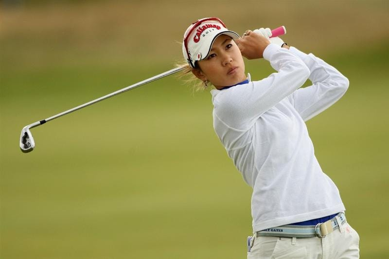 LYTHAM ST ANNES, UNITED KINGDOM - JULY 31:  Momoko Ueda of Japan hits her second shot on the 14th hole during the second round of the 2009 Ricoh Women's British Open Championship held at Royal Lytham St Annes Golf Club, on July 31, 2009 in  Lytham St Annes, England. (Photo by Warren Little/Getty Images)