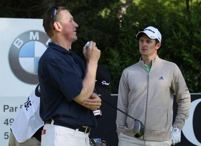 VIRGINIA WATER, ENGLAND - MAY 25:  Justin Rose (R) of England chats to Matthew Pinsent during the Pro-Am round prior to the BMW PGA Championship at Wentworth Club on May 25, 2011 in Virginia Water, England.  (Photo by Warren Little/Getty Images)