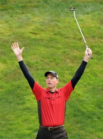 THOUSAND OAKS, CA - DECEMBER 06:  Jim Furyk celebrates a long putt to save par on the 17th hole during the fourth round of the Chevron World Challenge at Sherwood Country Club on December 6, 2009 in Thousand Oaks, California.  Furyk won the tournament by one shot.  (Photo by Harry How/Getty Images)