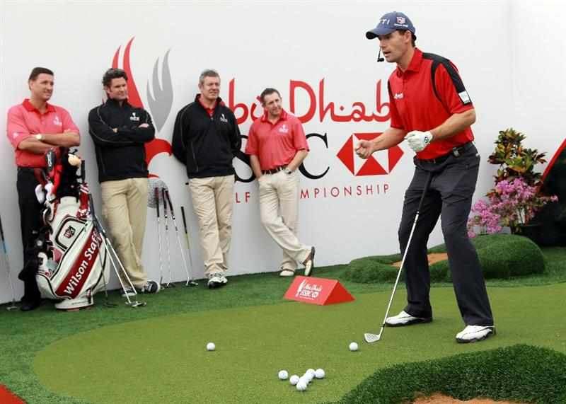 ABU DHABI, UNITED ARAB EMIRATES - JANUARY 22:  Padraig Harrington of Ireland (R) offers advice to (L to R) Simon Cooper, the CEO of HSBC Middle East and North Africa, HSBC sporting ambassadors Chris Cairns, Gavin Hastings and Jonathan Davies at a golf skills clinic during the third round of The Abu Dhabi HSBC Golf Championship at Abu Dhabi Golf Club on January 22, 2011 in Abu Dhabi, United Arab Emirates.  (Photo by Andrew Redington/Getty Images)