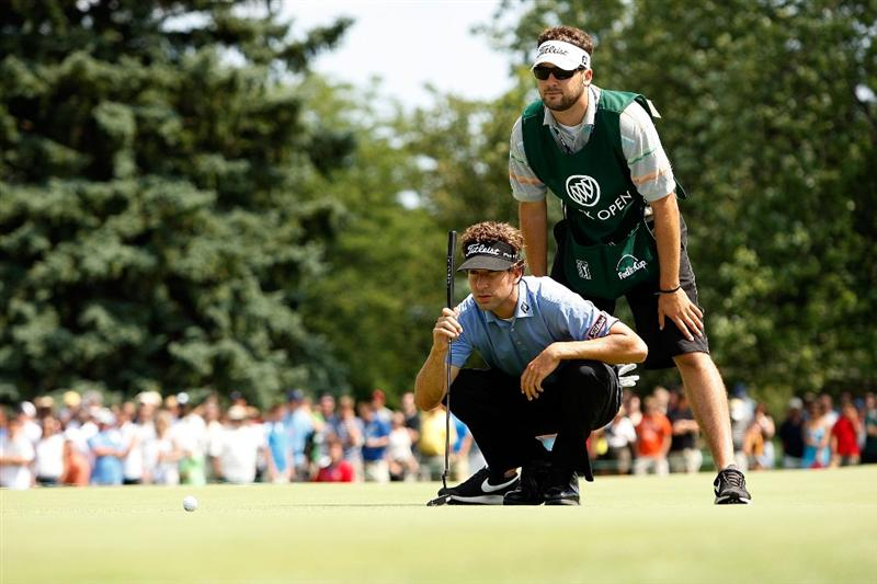 GRAND BLANC, MI - AUGUST 02:  Michael Letzig lines up a putt on the 6th hole during the final round of the Buick Open at Warwick Hills Golf and Country Club on August 2, 2009 in Grand Blanc, Michigan.  (Photo by Chris Graythen/Getty Images)