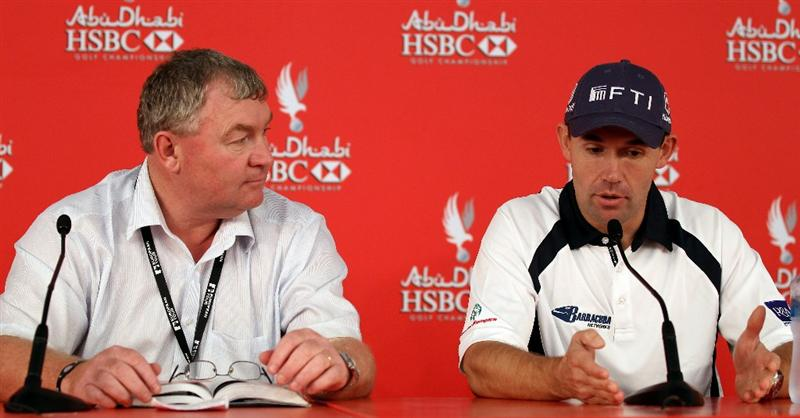 ABU DHABI, UNITED ARAB EMIRATES - JANUARY 21:  Padraig Harrington of Ireland with European Tour senior referee Andy McFee during a press conference after being disqualified before his second round of the Abu Dhabi HSBC Golf Championship at the Abu Dhabi Golf Club on January 21, 2011 in Abu Dhabi, United Arab Emirates.  (Photo by Ross Kinnaird/Getty Images)