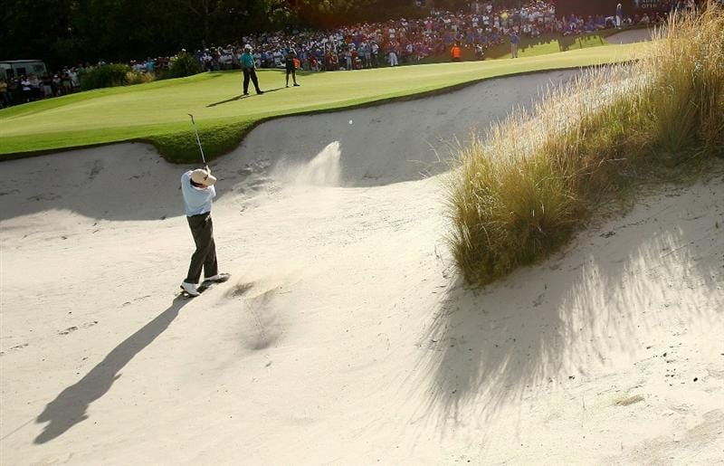 SYDNEY, AUSTRALIA - DECEMBER 14:  Tim Clark of South Africa chips from a bunker on the 18th hole in a playoff with Mathew Goggin of Australia during the fourth round of the 2008 Australian Open at The Royal Sydney Golf Club on December 14, 2008 in Sydney, Australia.  (Photo by Mark Nolan/Getty Images)
