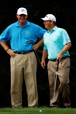 ST. LOUIS - SEPTEMBER 06:  Ernie Els jokes with Dudley Hart as they prepare to putt on the 7th hole during the second round of the BMW Championship on September 6, 2008 at Bellerive Country Club in St. Louis, Missouri.  (Photo by Jamie Squire/Getty Images)